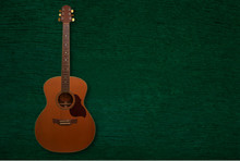Guitar On Green Board Background