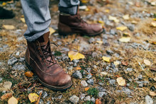A Pair Of Brown Hiking Boot In Autumn Forest. Soft Focus On Boot