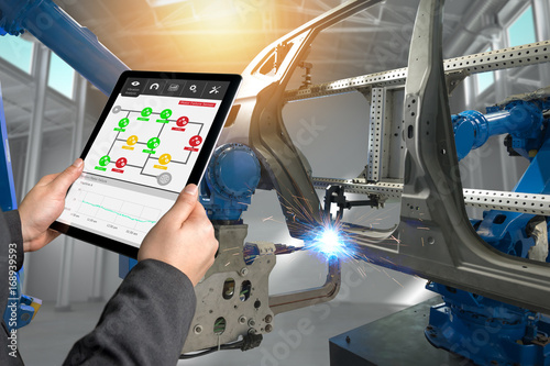 Fotografie, Obraz  Male manager hand use tablet for check real time vibration analysis monitoring system application in smart factory