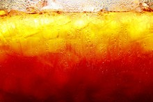 Mixed Cold Iced Tea In A Glass Container