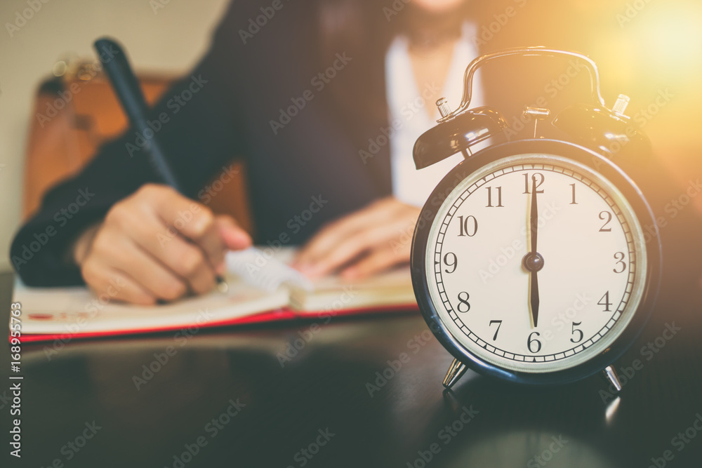 Fototapeta business working time concept. morning 6 o'clock with work people on background