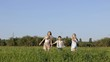 Three happy children playing in the field at the day time. Kid having fun outdoors. Concept of happy game.