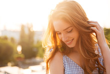 Close Up Portrait Of A Redhead Girl Playing With Hair