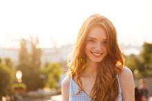 Happy Pretty Redhead Girl With Long Hair