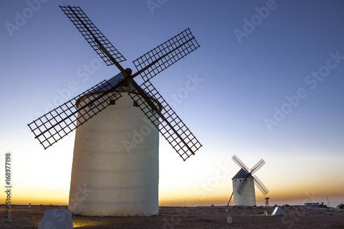 Fotografía  Illuminated traditional windmills at rising