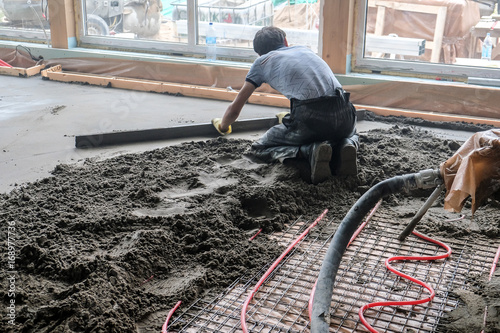 pouring concrete slab - Buy this stock photo and explore