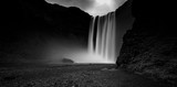 Black and white picture of Skogafoss, one of the most stunning waterfalls in Iceland - 168993968
