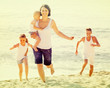 couple with two children running