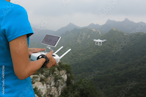 Printed kitchen splashbacks Khaki woman flying drone taking photo of the great wall landscape in China