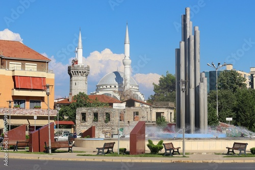 Shkoder, Albania: View of the central square Sheshi Demokracia with fountain, English tower, Ebu Bekr Mosque and Franciscan church Canvas Print