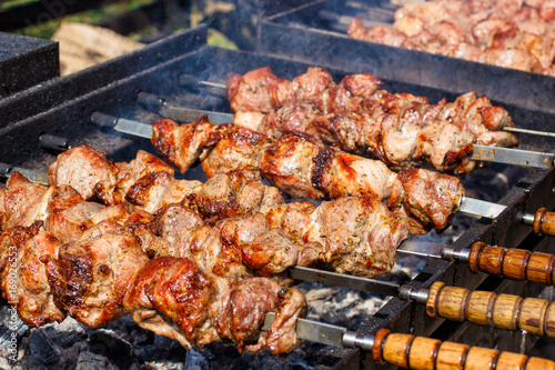 Tuinposter Grill / Barbecue Meat prepared on coals in a barbecue.