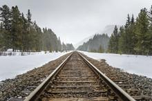 Railway Through The Mountains During A Heavy Snowfall