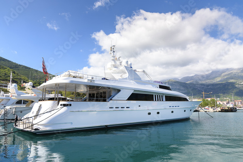 Garden Poster Water Motor sports luxurious white yacht parking at the port