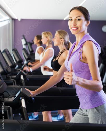 Poster Fitness Satisfied girls running on treadmills