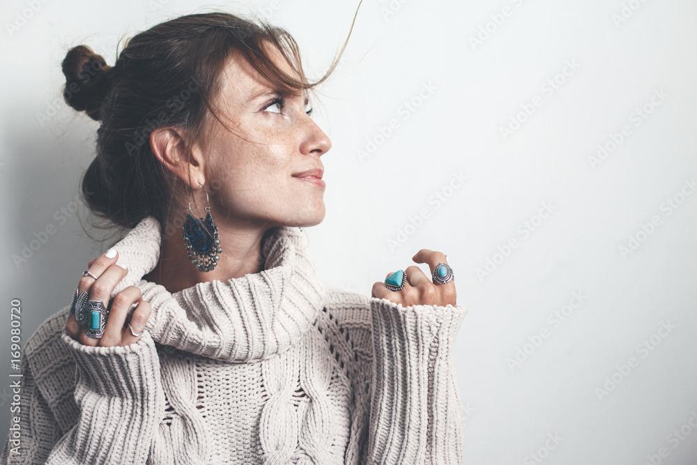Fototapeta Boho jewelry and woolen sweater on model