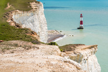 Red And White Beachy Head Lighthouse In Blue Sea English Channel Under Seven Sisters White Cliffs