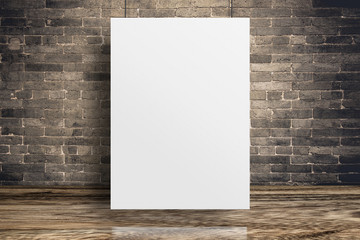 Blank white paper poster hanging at grunge brick wall and wood floor,Mock up template for adding your content or design,Business presentation.
