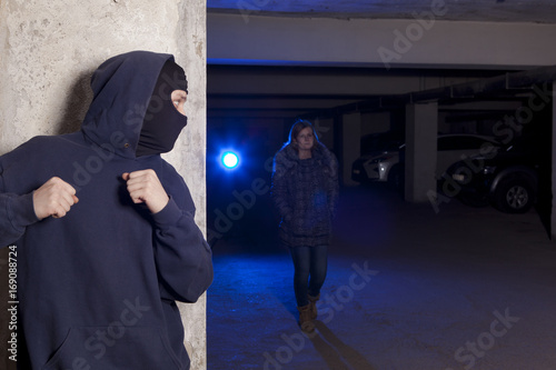 Criminal wearing a mask waiting for a woman Canvas Print