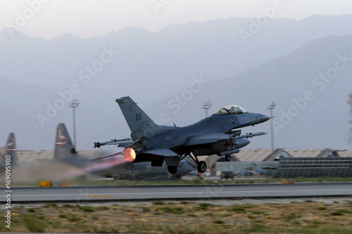 A U S  Air Force F-16 Fighting Falcon aircraft takes off for a
