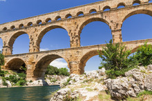 The Pont Du Gard Is An Ancient Roman Aqueduct That Crosses The Gardon River In South France. Horizontally.