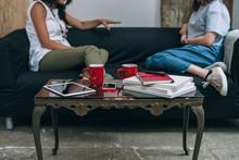 Two Women Friends Talking To E...