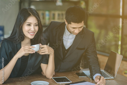 Fototapety, obrazy: Business couple work with laptop together at cafe, Young couple sitting at cafe and looking at laptop, business, people concept - happy creative team talking in modern office, Selective focus.
