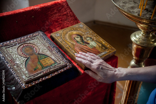 Papiers peints Affiche vintage Female hand on the icon of the Kazan Mother of God, Mother-of-God of Kazan, Our Lady of Kazan.