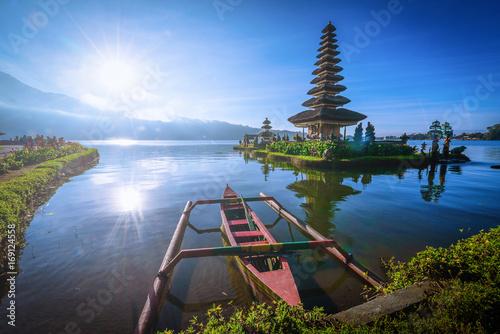 Tuinposter Bali Pura Ulun Danu Bratan, Hindu temple with boat on Bratan lake landscape at sunrise in Bali, Indonesia.