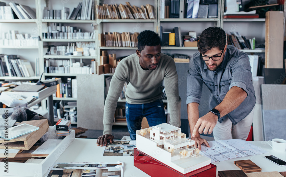 Fototapety, obrazy: Architects working on construction project in the office