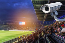 CCTV Surveillance Camera Security Operating In Football Stadium At  Twilight Time Background