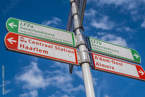 Direction signs in Amsterdam on a sunny day Canvas Print