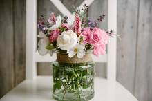 Pink, White And Lilac Garden Flowers In A Glass Jar.