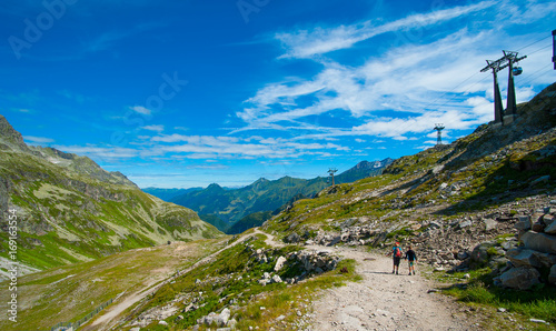 Poster Panoramafoto s alps landscape- mountains in front of blue sky