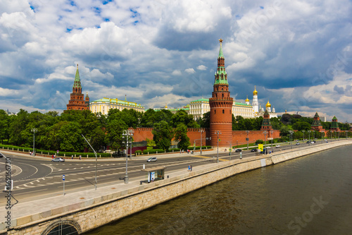 City on the water Kremlin and the Kremlin embankment in summer against the background of the cloudy sky. Thunderclouds