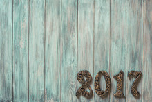 Metal Forged 2017 Date On Vintage Old Grunge Mint Green Painted Wooden Wall Planks Texture Background. Retro Instagram Style Filtered Photo
