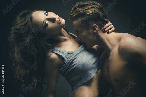 Fotografie, Obraz  Beautiful young smiling couple in love embracing indoor