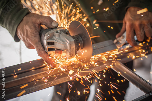 Fotografie, Obraz  Electric wheel grinding on steel structure in factory
