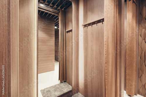 Fotografie, Obraz  Dressing room with a mirror lined with wood in a classic business style in a clothing store