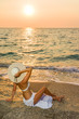 Woman hat on the beach at sunset