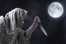 Man In Iron Mask With A Big Knife .