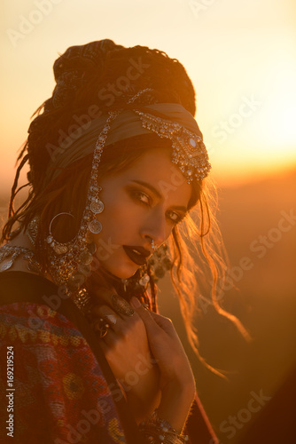 Foto auf Leinwand Gypsy boho woman on sunset