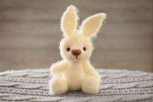 Knitted Toy Bunny On Blurred Background