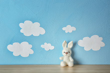 Cute Knitted Toy Bunny On Wood...