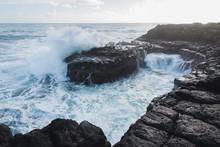 Wave Crashes Against Volcanic ...