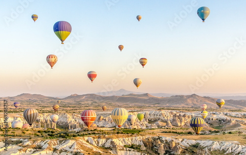 Fototapety, obrazy: Hot air balloons over mountains