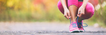 Running Shoes Runner Woman Tying Laces For Autumn Run In Forest Park Panoramic Banner Copy Space. Jogging Girl Exercise Motivation Heatlh And Fitness.