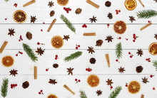 Autumn Winter Pattern Composition Of Branches Of An Tree, Cinnamon, Dried Orange, Anise Of Stars And Berries On White Wooden Background.Top View. Flat Lay