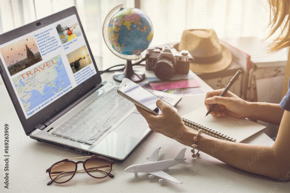 Fototapety, obrazy: Young women planning vacation trip and searching information