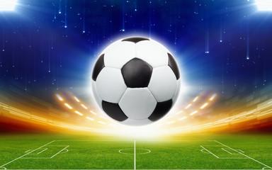 fototapeta piłka powyżej stadionu piłkarskiego w nocy