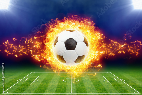 burning-soccer-ball-above-green-football-stadium